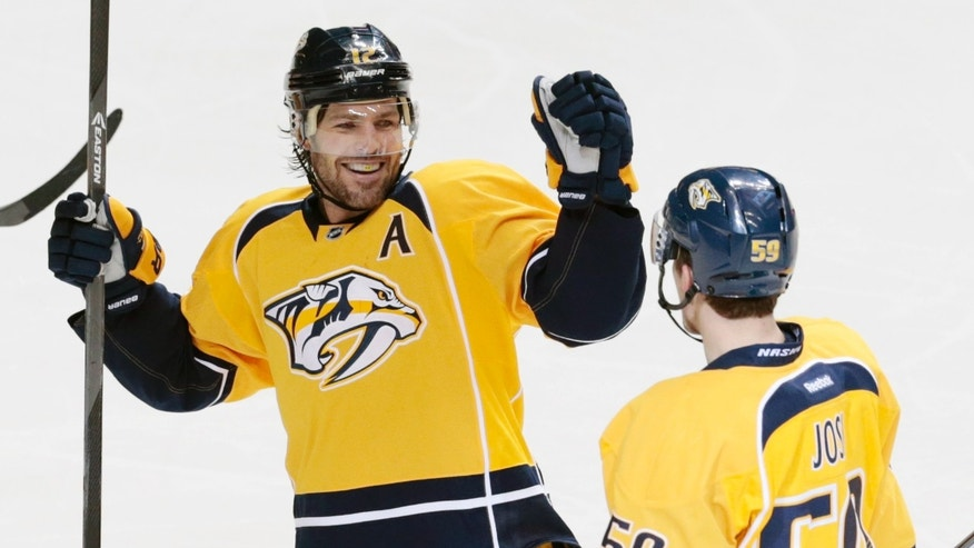 Nashville Predators defenseman Roman Josi (59), of Switzerland, is congratulated by Mike Fisher (12) after Josi scored against the San Jose Sharks in the second period of an NHL hockey game Tuesday, Jan. 7, 2014, in Nashville, Tenn. (AP Photo/Mark Humphrey)