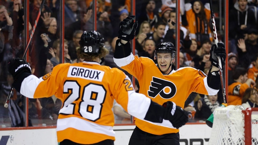 Philadelphia Flyers' Michael Raffl, right, of Austria, celebrates with Claude Giroux after Raffl scored during the second period of an NHL hockey game against the Montreal Canadiens, Wednesday, Jan. 8, 2014, in Philadelphia. (AP Photo/Matt Slocum)