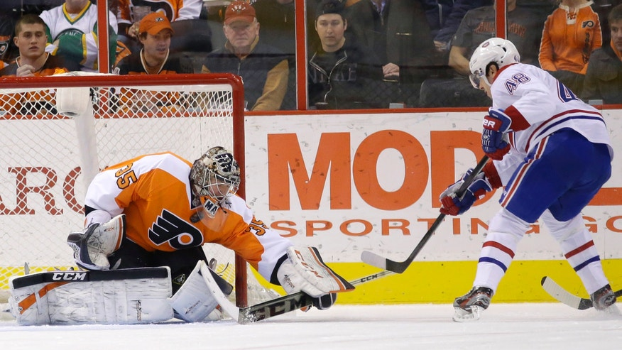 Philadelphia Flyers' Steve Mason, left, blocks a shot by Montreal Canadiens' Daniel Briere during the second period of an NHL hockey game, Wednesday, Jan. 8, 2014, in Philadelphia. (AP Photo/Matt Slocum)