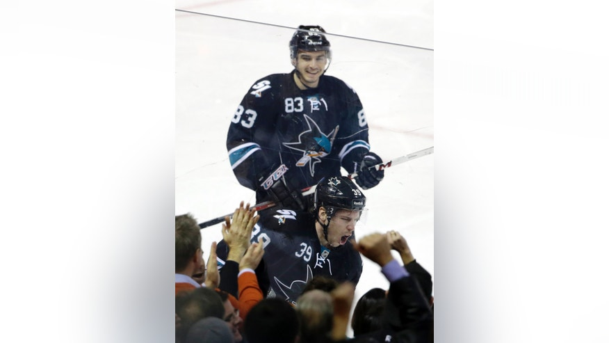 San Jose Sharks' Logan Couture (39) celebrates his goal against the Edmonton Oilers with teammate Matt Nieto (83) during the second period of an NHL hockey game on Thursday, Jan. 2, 2014, in San Jose, Calif. (AP Photo/Marcio Jose Sanchez)
