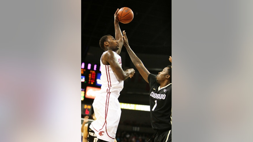 Washington State's D.J. Shelton, left, attempts a jump shot against Colorado's Wesley Gordon during the first half of an NCAA college basketball game Wednesday, Jan. 8, 2014, in Spokane, Wash. (AP Photo/Young Kwak)