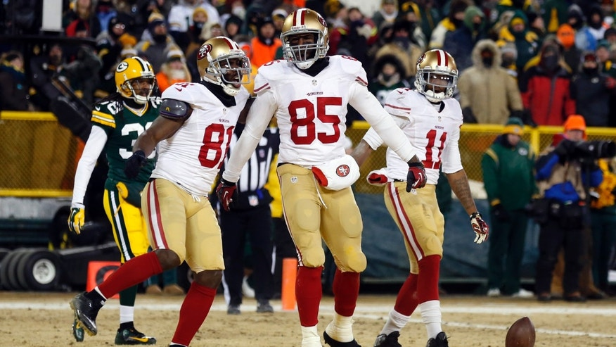 San Francisco 49ers tight end Vernon Davis (85) celebrates a touchdown catch with wide receiver Anquan Boldin (81) during the second half of an NFL wild-card playoff football game, Sunday, Jan. 5, 2014, in Green Bay, Wis. (AP Photo/Jeffrey Phelps)