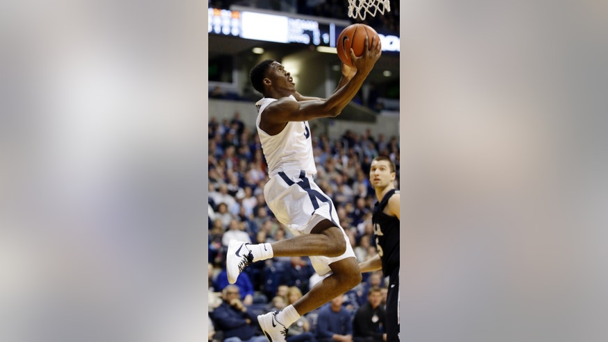 Xavier guard Semaj Christon scores against Butler in the first half of an NCAA college basketball game, Saturday, Jan. 4, 2014, in Cincinnati. Christon led Xavier to a 79-68 win with 20 points. (AP Photo/Al Behrman)