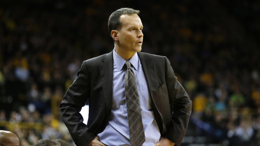 Northwestern coach Chris Collins watches during the first half of an NCAA college basketball game against Iowa, Thursday, Jan. 9, 2014, in Iowa City, Iowa. (AP Photo/Charlie Neibergall)