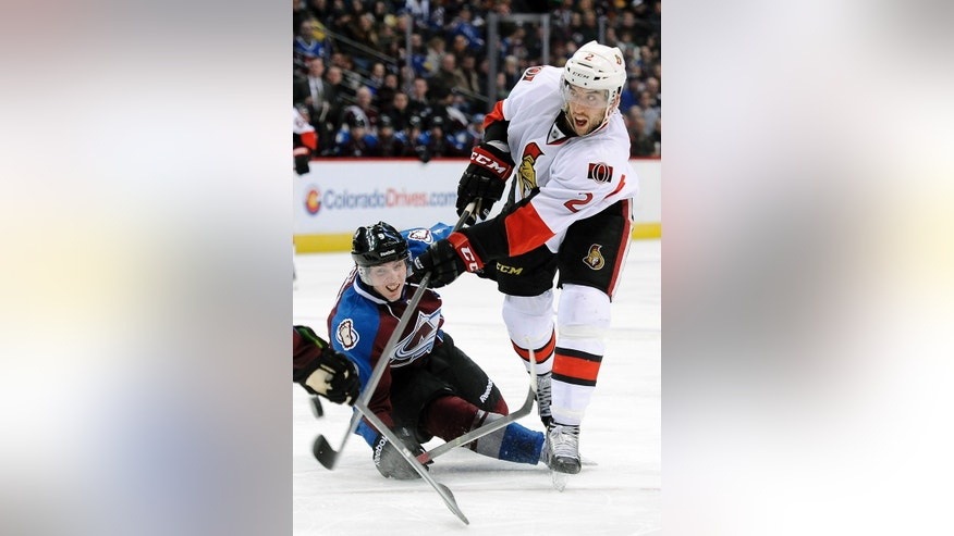 Ottawa Senators defenseman Jared Cowen shoots past Colorado Avalanche center Matt Duchene in the second period of an NHL hockey game on Wednesday, Jan. 8, 2014, in Denver. (AP Photo/Chris Schneider)