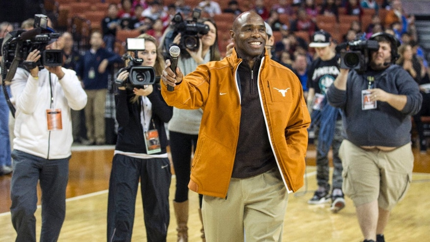 Texas new head football coach Charlie Strong speaks to fans during a timeout against Oklahoma in the first half of an NCAA college basketball game in Austin, Texas, Wednesday, Jan. 8, 2014. (AP Photo/Austin American- Statesman, Ricardo B. Brazziell) AUSTIN CHRONICLE OUT; COMMUNITY IMPACT OUT; INTERNET MUST CREDIT PHOTOGRAPHER AND STATESMAN.COM