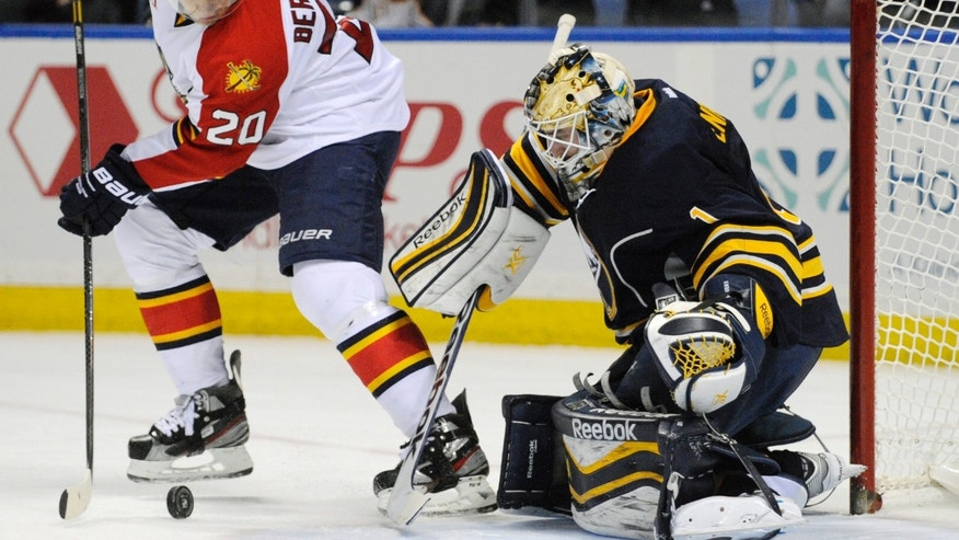 Florida Panthers' Sean Bergenheim (20), of Finland, shoots the puck against Buffalo Sabres' Jhonas Enroth (1), of Sweden, during the second period of an NHL hockey game in Buffalo, N.Y., Thursday, Jan. 9, 2014. (AP Photo/Gary Wiepert)