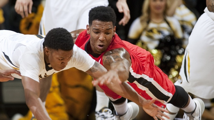 Georgia's Charles Mann, right, and Missouri's Wes Clark, left, battle for a loose ball during the first half of an NCAA college basketball game Wednesday, Jan. 8, 2014, in Columbia, Mo. (AP Photo/L.G. Patterson)