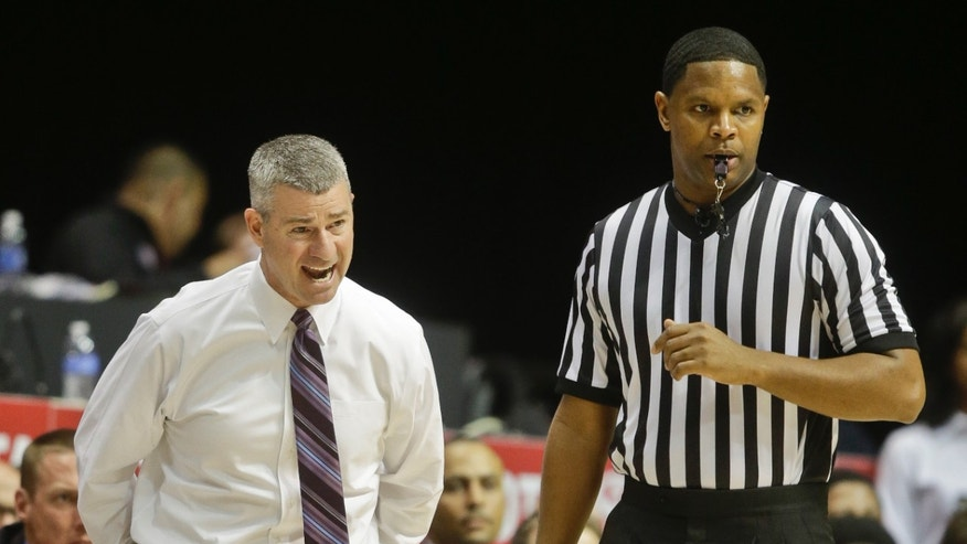 Boise State coach Leon Rice lets a referee know his feelings during the second half of San Diego State's 69-66 victory over Boise State in an NCAA college basketball game Wednesday, Jan. 8, 2014, in San Diego. (AP Photo/Lenny Ignelzi)