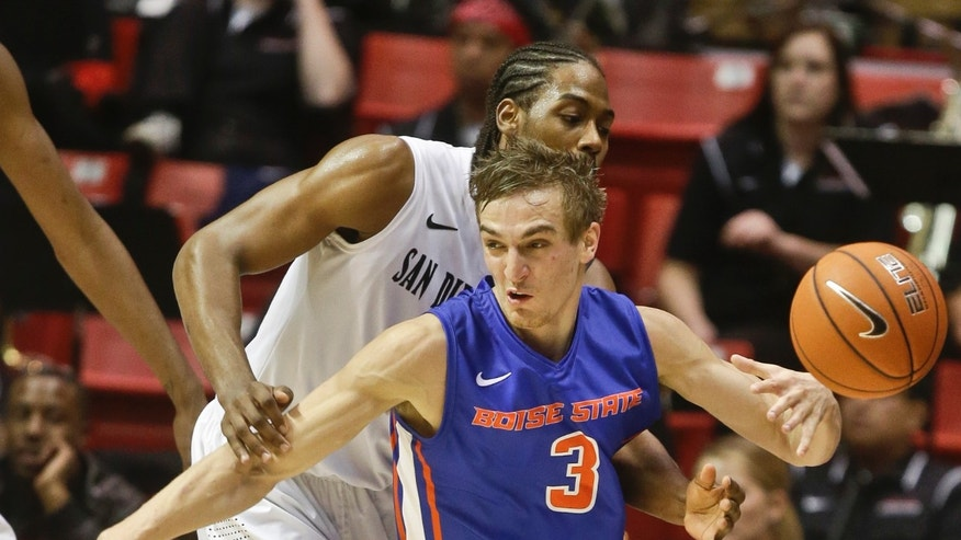 Boise State forward Anthony Drmic has the ball knocked away by San Diego State forward Josh Davis for a turnover during the second half of San Diego State's 69-66 victory in an NCAA college basketball game Wednesday, Jan. 8, 2014, in San Diego. (AP Photo/Lenny Ignelzi)