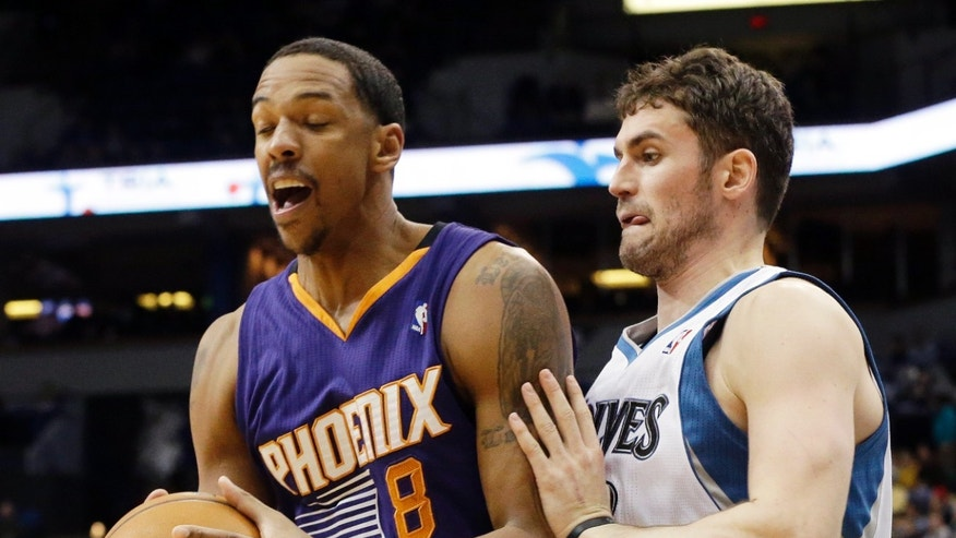 Phoenix Suns' Channing Frye, left, hangs tightly to the ball as Minnesota Timberwolves' Kevin Love  defends in the second half of an NBA basketball game  Wednesday, Jan. 8, 2014, in Minneapolis. The Suns won 104-103. Frye score 22 points while Love scored 25 and had12 rebounds. (AP Photo/Jim Mone)