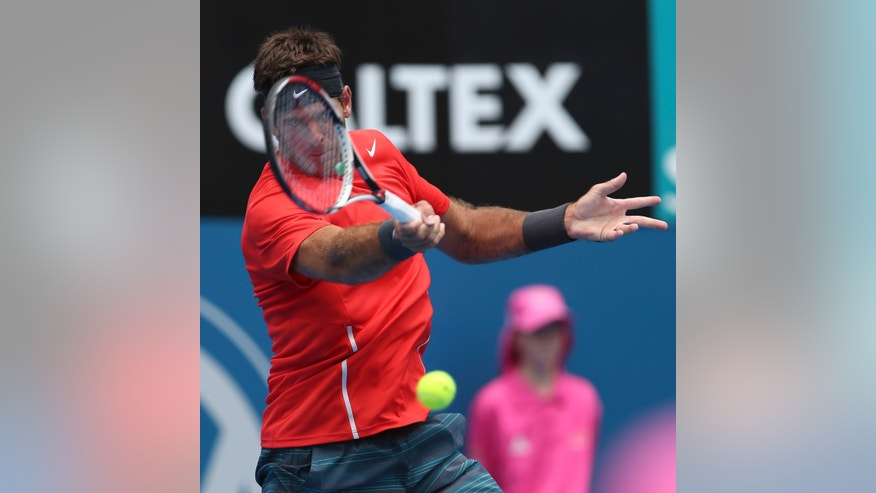 Juan Martin del Potro of Argentina plays a shot in his quarterfinals match against Radek Stepanek of the Czech Republic during the Sydney International tennis tournament in Sydney, Australia, Thursday, Jan. 9, 2014. (AP Photo/Rob Griffith)