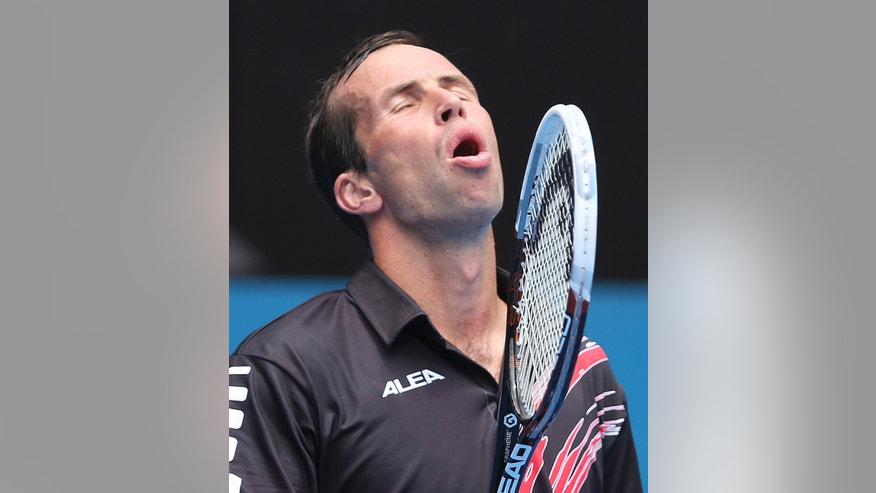 Radek Stepanek of the Czech Republic throws his head back as he cries out after missing a shot in his quarterfinals match against Juan Martin del Potro of Argentina during the Sydney International tennis tournament in Sydney, Australia, Thursday, Jan. 9, 2014. (AP Photo/Rob Griffith)