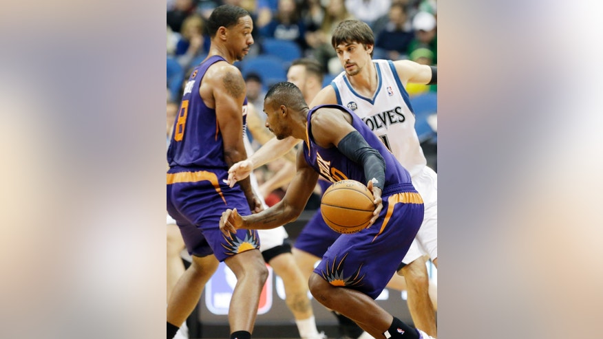 Phoenix Suns' Channing Frye, left, sets a pick on Minnesota Timberwolves' Alexey Shved, right, of Russia, as Leandro Barbosa, of Brazil, drives by in the first quarter of an NBA basketball game on Wednesday, Jan. 8, 2014, in Minneapolis. (AP Photo/Jim Mone)
