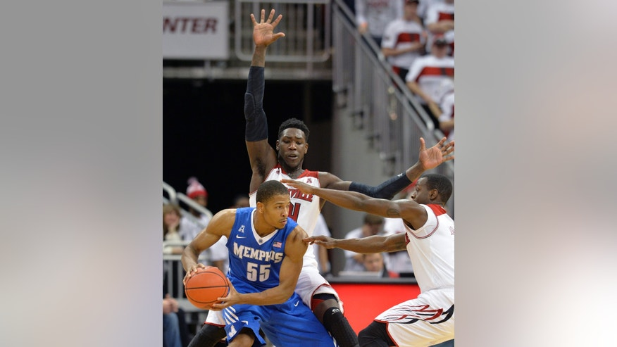 Memphis' Geron Johnson (55) looks for help against the trapping defense of Louisville's Montrezl Harrell, top, and Chris Jones, right, during the second half of an NCAA college basketball game on Thursday Jan. 9, 2014, in Louisville, Ky. Memphis defeated Louisville 73-67. (AP Photo/Timothy D. Easley)