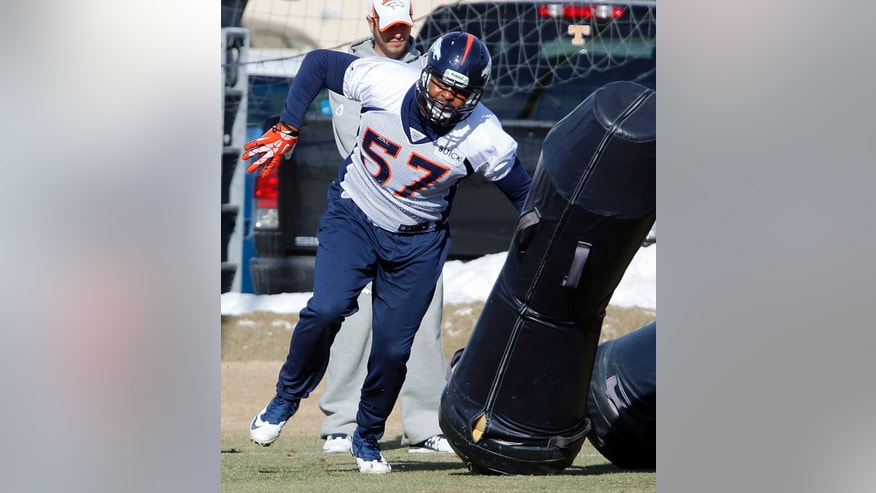 Denver Broncos defensive end Jeremy Mincey (57) hits a blocking dummy during practice for the football team's NFL playoff game against the San Diego Chargers at the Broncos training facility in Englewood, Colo., on Thursday, Jan. 9, 2014. (AP Photo/Ed Andrieski)