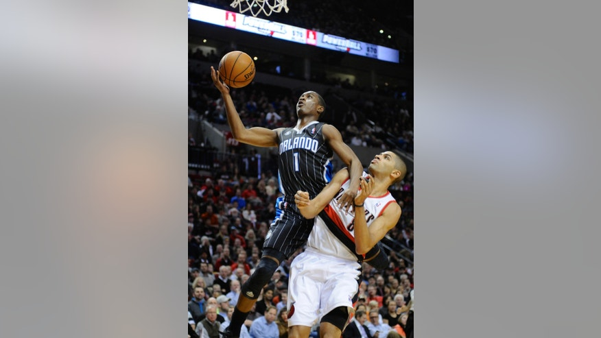Orlando Magic's Doron Lamb (1) shoots against Portland Trail Blazers' Nicolas Batum during the first half of an NBA basketball game in Portland, Ore.,Wednesday Jan 8, 2014. (AP Photo/Greg Wahl-Stephens)