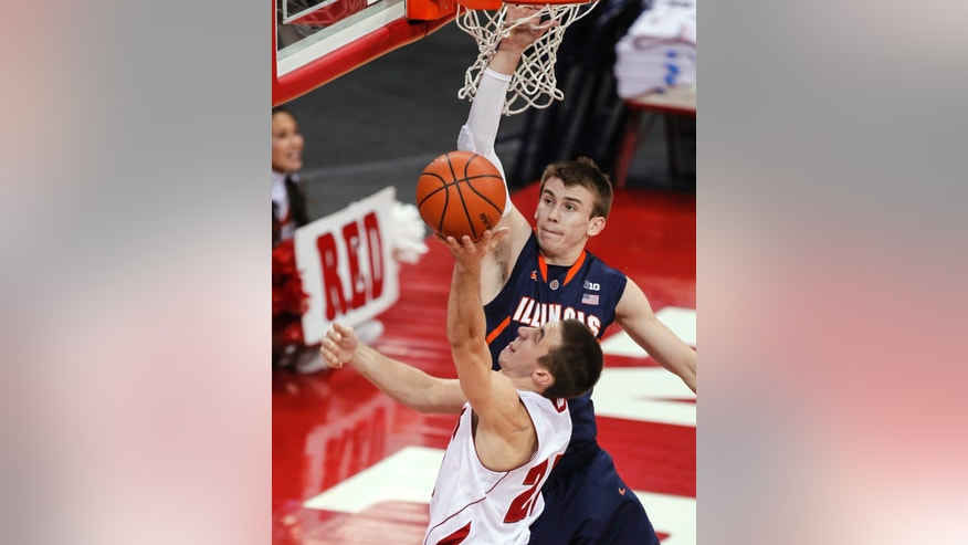 Wisconsin's Josh Gasser shoots against Illinois' Jon Ekey during the first half of an NCAA college basketball game Wednesday, Jan. 8, 2014, in Madison, Wis. (AP Photo/Andy Manis)