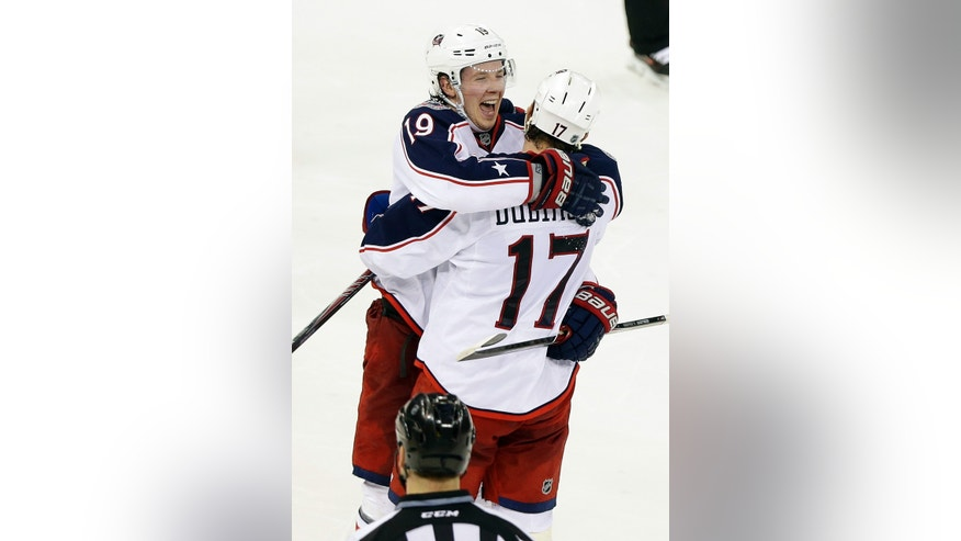 Columbus Blue Jackets center Ryan Johansen (19) celebrates with teammate Brandon Dubinsky (17) after scoring the game winning goal during the shootout period of an NHL hockey game against the New York Rangers Monday, Jan. 6, 2014, in New York. The Blue Jackets won the game 4-3 in a shootout. (AP Photo/Frank Franklin II)