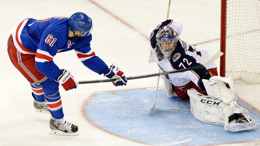 Columbus Blue Jackets goalie Sergei Bobrovsky (72), of Russia, stops a shot on the goal by New York Rangers' Rick Nash (61) during the shootout period of an NHL hockey game Monday, Jan. 6, 2014, in New York. The Blue Jackets won the game 4-3 in a shootout. (AP Photo/Frank Franklin II)