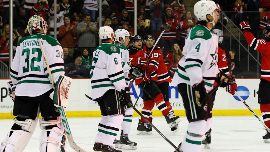 New Jersey Devils right wing Michael Ryder is congratulated by teammate New Jersey Devils center Travis Zajac (19) after scoring a goal against Dallas Stars goalie Kari Lehtonen (32), of Finland, during the second period of an NHL hockey game Thursday, Jan. 9, 2014, in Newark, N.J. (AP Photo/Adam Hunger)