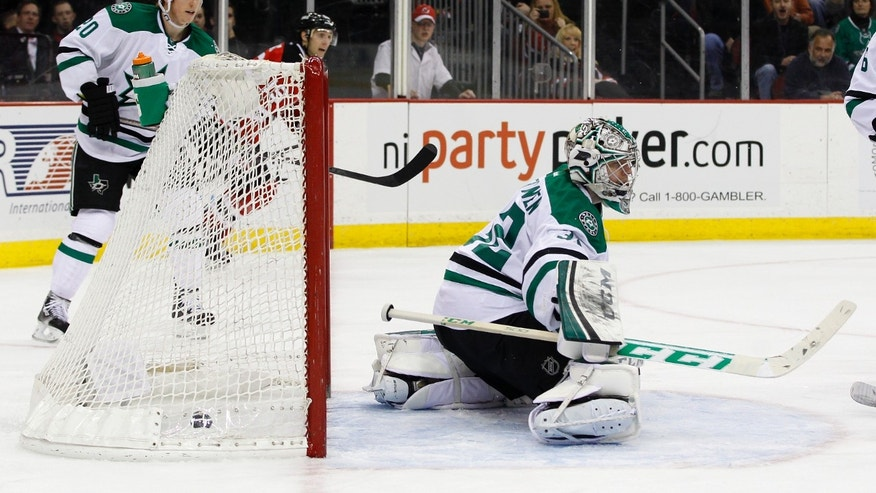 Dallas Stars goalie Kari Lehtonen, of Finland,  gives up a goal to New Jersey Devils right wing Michael Ryder during the second period of an NHL hockey game Thursday, Jan. 9, 2014, in Newark, N.J. (AP Photo/Adam Hunger)
