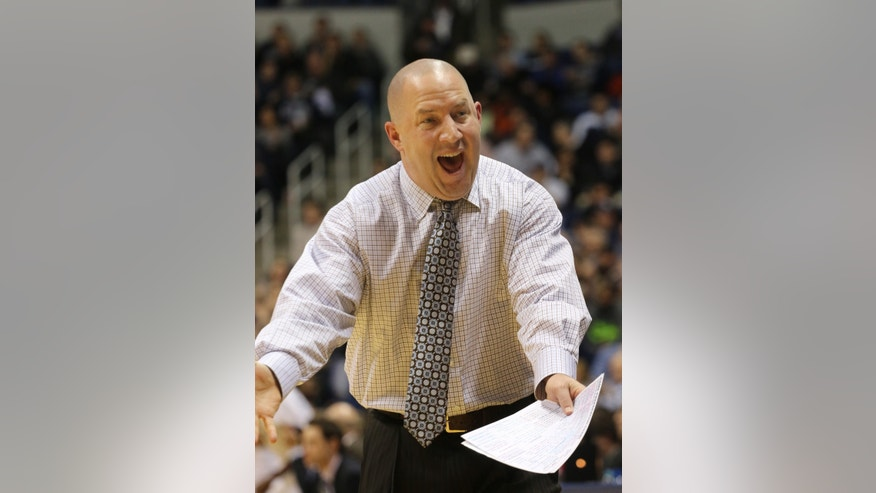 Marquette coach Buzz Williams yells at a player in the first half of their NCAA college basketball game at Xavier in Cincinnati, Thursday, Jan. 9, 2014. (AP Photo/Tom Uhlman)