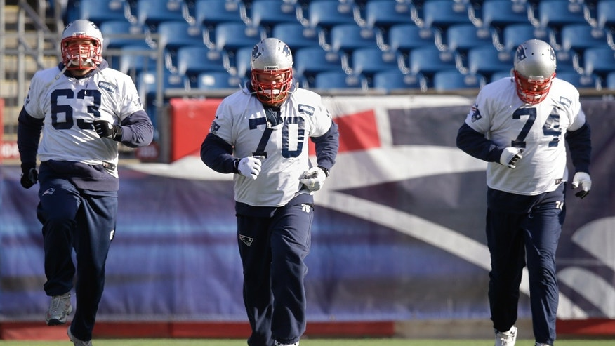 New England Patriots guards Dan Connolly (63), Logan Mankins (70) and tackle Will Svitek (74) run during a stretching session before practice begins at the NFL football team's facility in Foxborough, Mass., Wednesday, Jan. 8, 2014. The Patriots will play the Indianapolis Colts in an NFL divisional playoff game at Foxborough Saturday night. (AP Photo/Stephan Savoia)