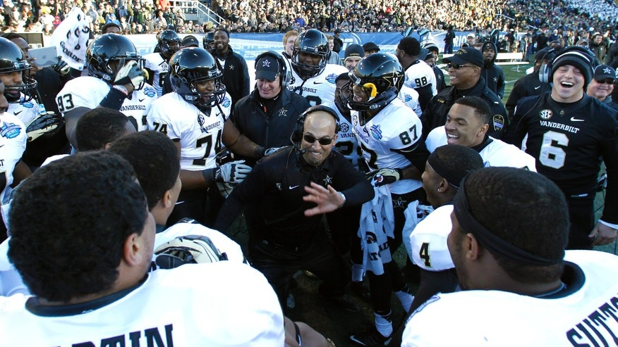 Vanderbilt coach James Franklin celebrates with team as he dances on the sideline during the second half of the BBVA Compass Bowl NCAA college football game on Saturday, Jan. 4, 2014, in Birmingham, Ala. Vanderbilt defeated Houston 41-24. (AP Photo/Butch Dill)