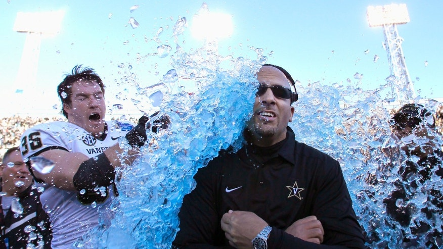 Vanderbilt coach James Franklin is doused by linebacker Chase Garnham (36) after they defeated Houston 41-24 in the BBVA Compass Bowl NCAA college football game on Saturday, Jan. 4, 2014, in Birmingham, Ala. (AP Photo/Butch Dill)