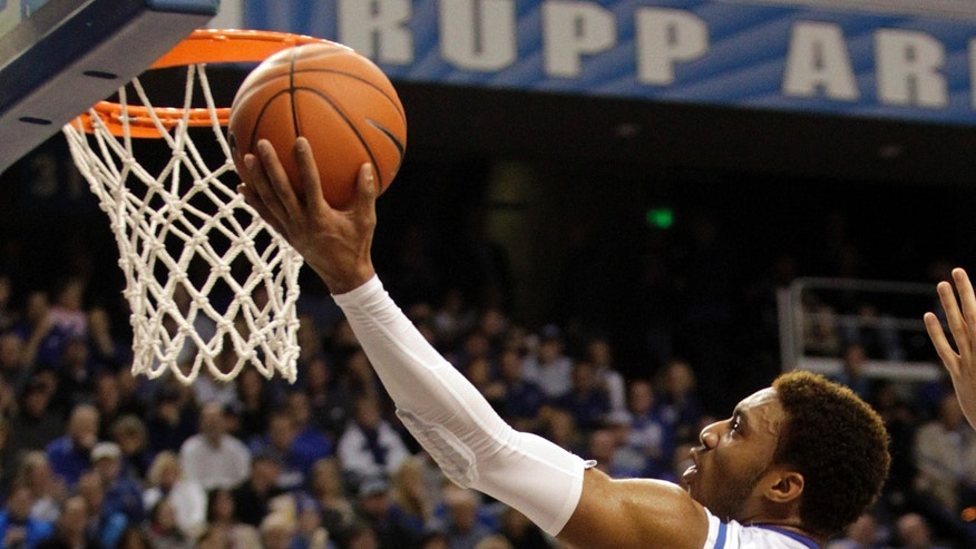 Kentucky's James Young (1) shoots during the first half of an NCAA college basketball game against Mississippi State, Wednesday, Jan. 8, 2014, in Lexington, Ky. (AP Photo/James Crisp)