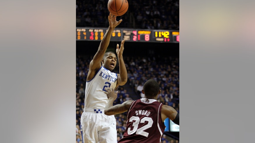 Kentucky's Aaron Harrison (2) passes over Mississippi State's Craig Sword (32) during the first half of an NCAA college basketball game, Wednesday, Jan. 8, 2014, in Lexington, Ky. (AP Photo/James Crisp)