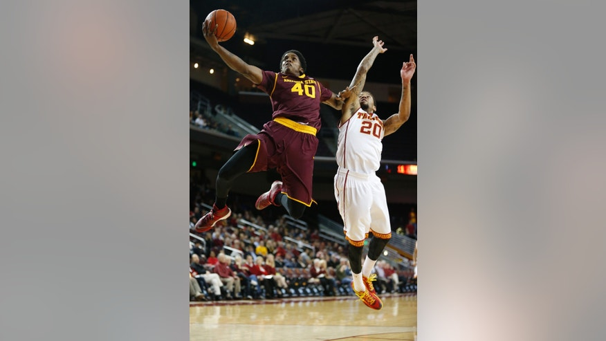 Arizona State's Shaquielle McKissic, left, goes to the basket to score past Southern California's J.T. Terrell during the first half of an NCAA college basketball game, Thursday, Jan. 9, 2014, in Los Angeles. (AP Photo/Danny Moloshok)