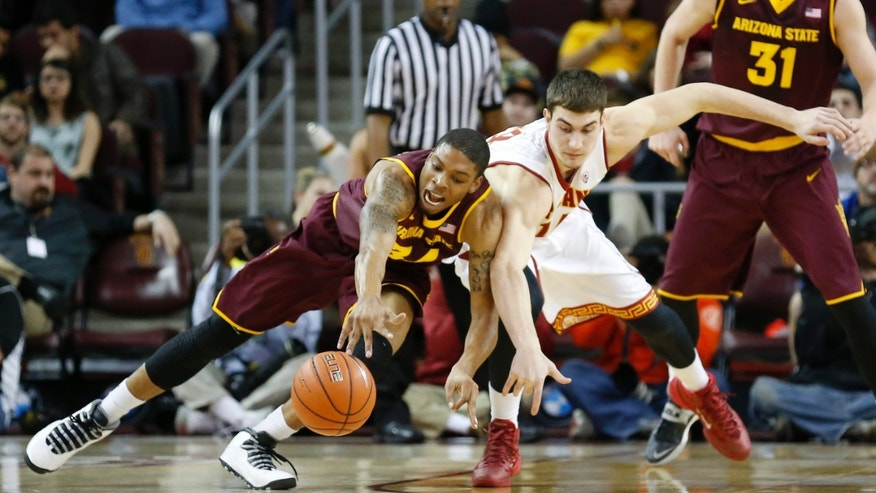 Arizona State's Jermaine Marshall, left, and Southern California's Strahinja Gavrilovic lean against each other while going for a loose ball during the first half of an NCAA college basketball game, Thursday, Jan. 9, 2014, in Los Angeles. (AP Photo/Danny Moloshok)