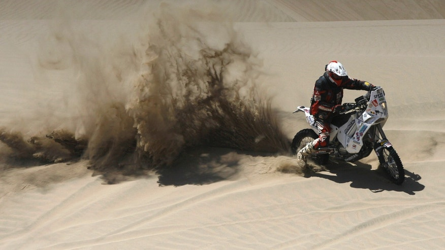 FILE - In this Jan. 13, 2012 file photo, biker Eric Palante, from Belgium, races his KTM during the 2012 Argentina-Chile-Peru Dakar Rally between Arequipa and Nazca, Peru. According to a statement from Dakar organizers, Palante's body was found on the morning of Jan. 10, 2014 along the route of the 2014 Dakar Rally between Chilecito and San Miguel de Tucuman, Argentina. (AP Photo/Martin Mejia, File)