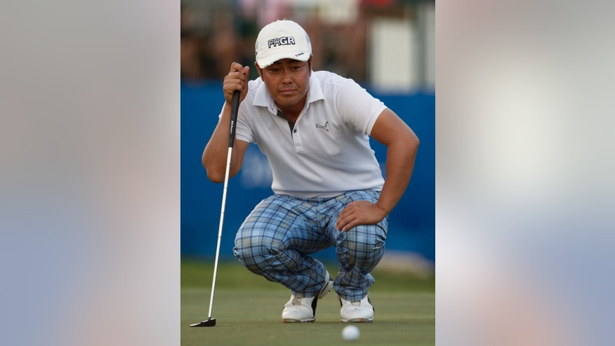 Hideto Tanihara, of Japan, lines up his putt on the 18th green during the second round of the Sony Open golf tournament on Friday, Jan. 10, 2014, in Honolulu. (AP Photo/Marco Garcia)