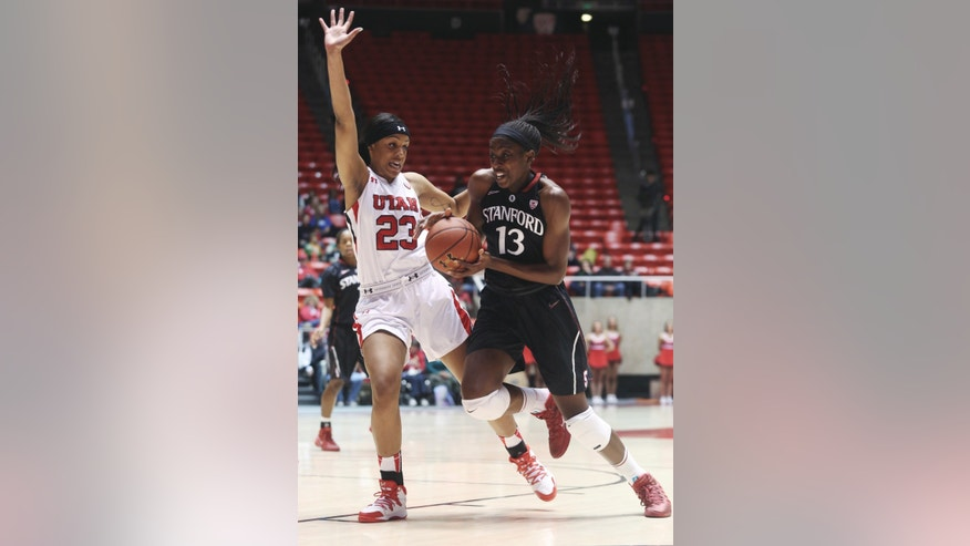 Stanford's Chiney Ogwumike (13) drives to the basket as Utah's Ariel Reynolds (23) defends during the first half of an NCAA college basketball game Friday, Jan. 10, 2014, in Salt Lake City. (AP Photo/Kim Raff)