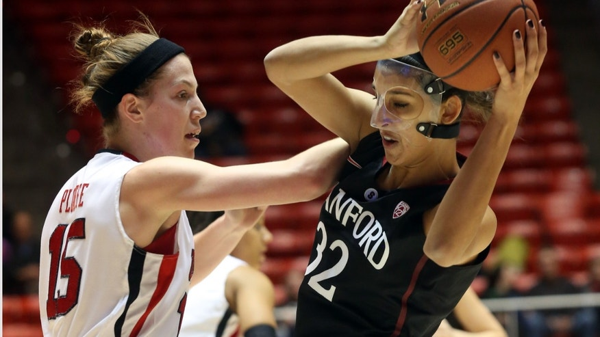 Stanford's Kailee Johnson (32) looks for an opening as Utah's Michelle Plouffe (15) defends in the first half of an NCAA college basketball game Friday, Jan. 10, 2014, in Salt Lake City. (AP Photo/Kim Raff)