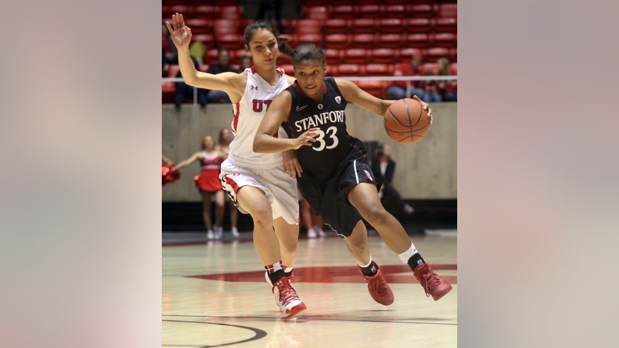 Stanford's Amber Orrange (33) dribbles past Utah's Malia Nawahine during the first half of an NCAA college basketball game Friday, Jan. 10, 2014, in Salt Lake City. (AP Photo/Kim Raff)