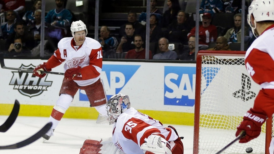Detroit Red Wings goalie Jimmy Howard is beaten for a goal on a shot by San Jose Sharks' Joe Pavelski during the first period of an NHL hockey game Thursday, Jan. 9, 2014, in San Jose, Calif. (AP Photo/Marcio Jose Sanchez)