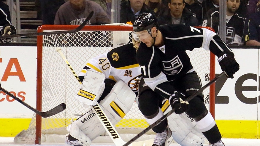 Los Angeles Kings center Jeff Carter (77) maneuvers past Boston Bruins goalie Tuukka Rask (40), of Finland, in the first period of an NHL hockey game in Los Angeles, Thursday, Jan. 9, 2014. (AP Photo/Reed Saxon)