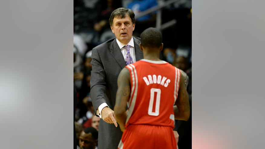 Houston Rockets head coach Kevin McHale talks to guard Aaron Brooks (0) as he comes off the court in the first half of an NBA basketball game against the Atlanta Hawks on Friday, Jan. 10, 2014, in Atlanta. (AP Photo/David Tulis)