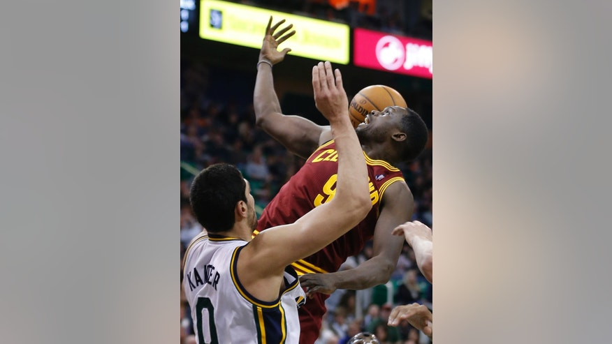 Cleveland Cavaliers Luol Deng, right, loses control of the ball as Utah Jazz's Enes Kanter defends during the first half of an NBA basketball game in Salt Lake City, Friday, Jan. 10, 2014. Cavaliers defeated the Jazz 113-102. (AP photo/George Frey)