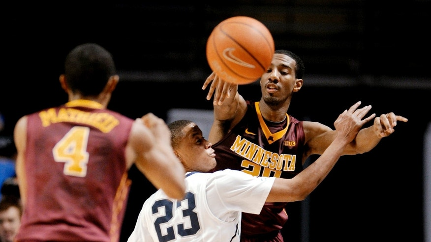 Minnesota's Austin Hollins passes the ball to teammate DeAndre Mathieu over Penn State's Tim Frazier during an NCAA college basketball game Wednesday, Jan. 8, 2014, in State College, Pa. (AP Photo/Centre Daily Times, Abby Drey) MANDATORY CREDIT  MAGS OUT