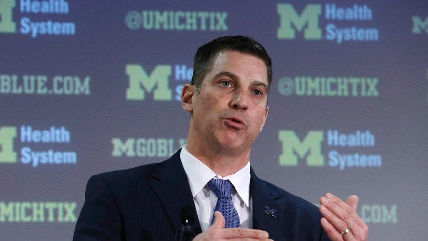 Doug Nussmeier is introduced as Michigan's NCAA college football offensive coordinator and quarterbacks coach during a news conference at the Junge Center in Ann Arbor, Mich., Friday, Jan. 10, 2014. Nussmeier is the former Alabama offensive coordinator. (AP Photo/Carlos Osorio)