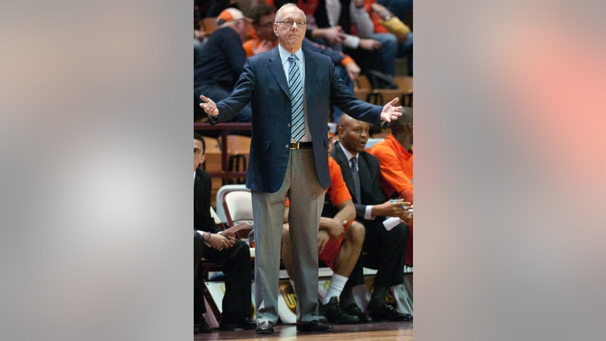 Syracuse coach Jim Boeheim gestures to the referees during the first half of an NCAA college basketball game between Syracuse and Virginia Tech on Tuesday, Jan. 7,  2014, in Blacksburg, Va. Syracuse won 72-52. (AP Photo/Don Petersen)
