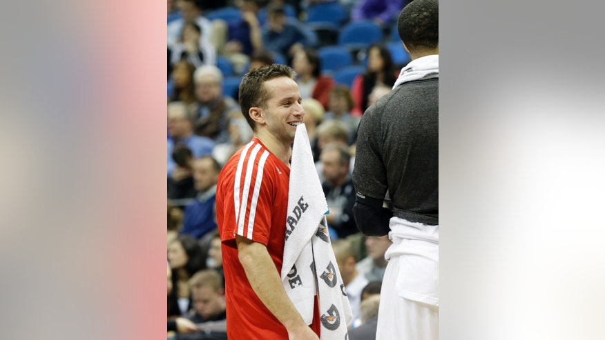 Minnesota Timberwolves' J.J. Barea enjoys a lighter moment during a timeout in the second half of an NBA basketball game Friday, Jan. 10, 2014, in Minneapolis where the Timberwolves bet the Charlotte Bobcats 119-92. (AP Photo/Jim Mone)