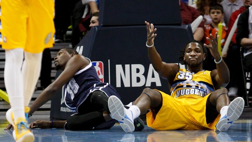 Denver Nuggets' Kenneth Faried, right, reacts after fouling Oklahoma City Thunder's Kevin Durant, left, during the first quarter of an NBA basketball game, Thursday, Jan. 9, 2014, in Denver. (AP Photo/Barry Gutierrez)