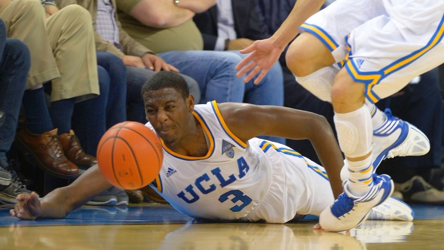 UCLA guard Jordan Adams dives for a loose ball during the second half of an NCAA college basketball game against Arizona, Thursday, Jan. 9, 2014, in Los Angeles. (AP Photo/Mark J. Terrill)