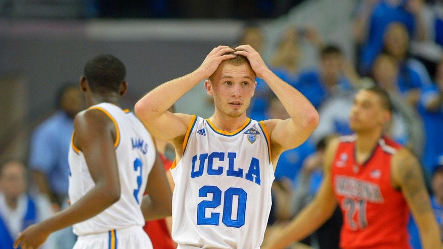 UCLA guard Bryce Alford, center, reacts to a call that went against them during the second half of an NCAA college basketball game against Arizona, Thursday, Jan. 9, 2014, in Los Angeles. (AP Photo/Mark J. Terrill)